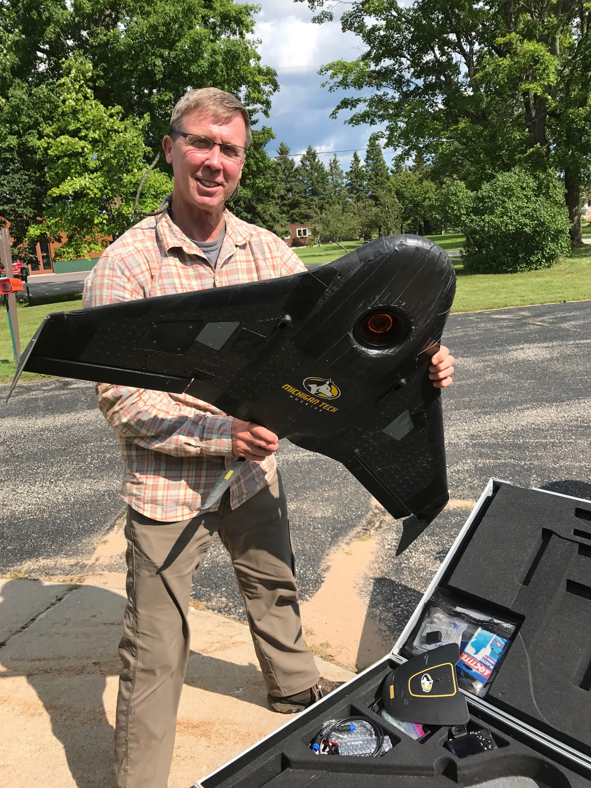 Dr. Curtis Edson, Assistant Professor of Remote Sensing and Geographic Information Systems at MTech,hold the UAV used in the drone flights over the Hiawatha National Forest. (Photo credit: US Forest Service.)