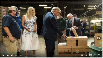 President Trump and others checking the food boxes