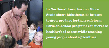 In Northeast Iowa, Farmer Vince Spain shows kids the seeds he uses to grow produce for their cafeteria. Farm-to-school programs can increase healthy food access while teaching young people about agriculture.