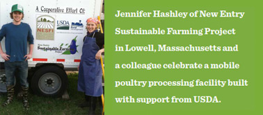 Jennifer Hashley of New Entry Sustainable Farming Project in Lowell, Massachusetts and a colleague celebrate a mobile poultry processing facility built with support from USDA.