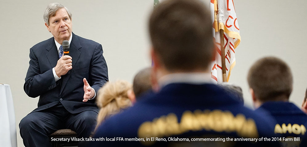 Secretary Visack talks with local FFA members, in El Reno, Oklahome, commemorating the anniversary of the 2014 Famr Bill