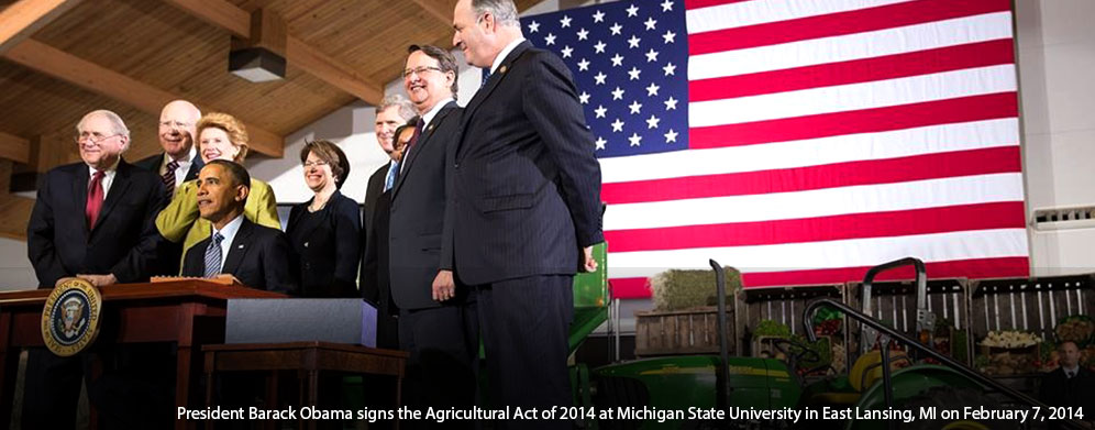 President Barack Obama signs the Agricultural Act of 2014 at Michigan State University in East Lansing, MI on February 7, 2014