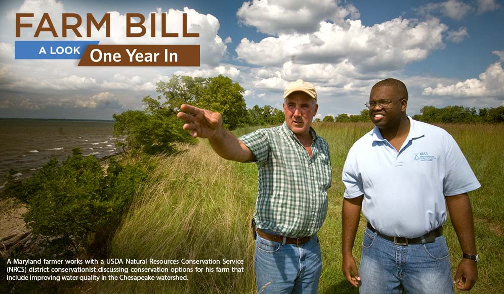 Farm Bill: A Look One Year In - A Maryland farmer works with a USDA Natural Resources Conservation Service (NRCS) district conservationist discussing conservation options for his farm that include improving water quality in the Chesapeake watershed.