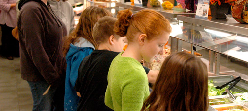 Students in western Michigan line up for local produce at lunch. The Onekama School District developed a farm-to-school program that has increased school lunch participation by 40%.