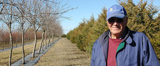 Ken Mouw knows about harsh winter winds and worked with USDA's Farm Service Agency to create a shelterbelt 10 years ago to fortify his farm.