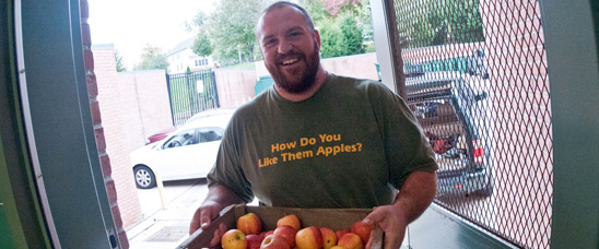 Bigg Riggs Farm owner Calvin Riggleman brings three varieties of apples to Nottingham Elementary School in Arlington, VA, for a National School Lunch Week event.
