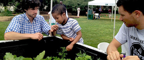 Bronson Brown and staff from D.C. Central Kitchen explores USDA's People's Garden on the opening day of the USDA Farmers Market.