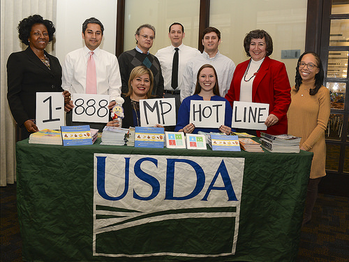 USDA Food Safety Education staff showing the Meat and Poultry Hotline number
