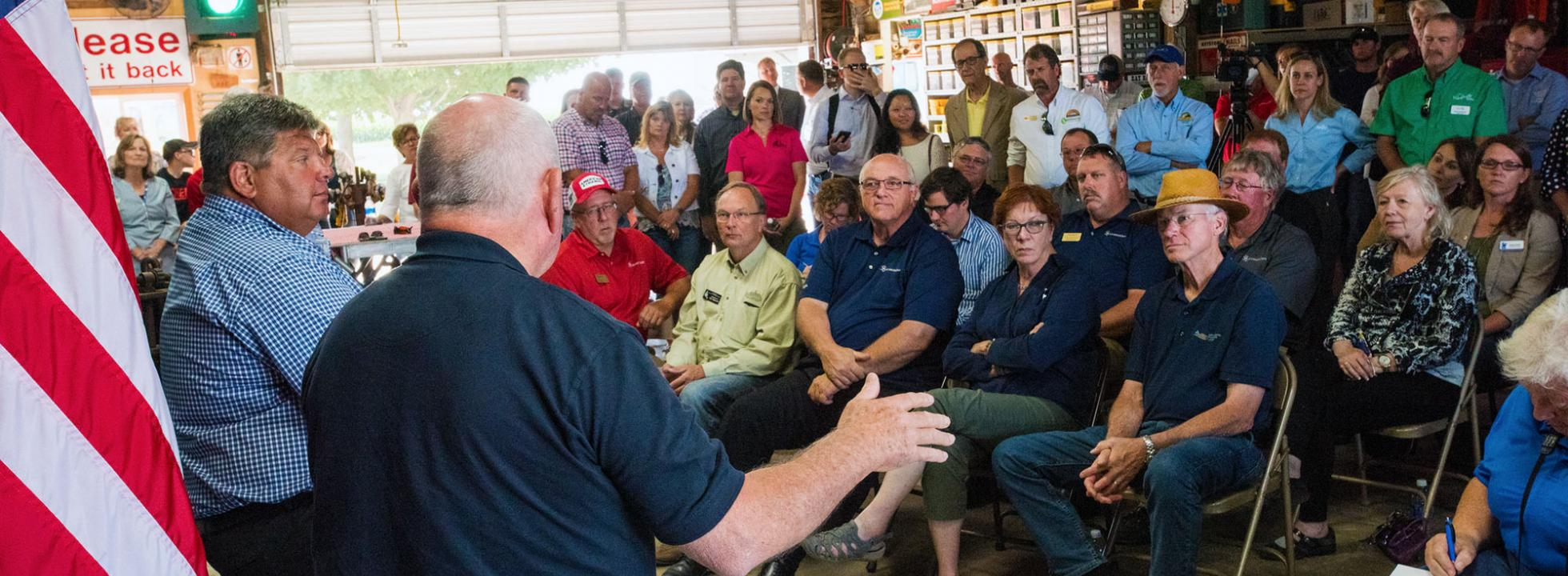 Secretary Perdue speaks to a group of Farmers