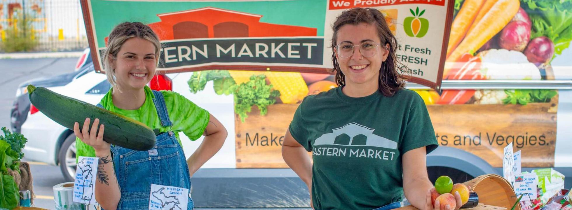 Two young farmers at a farmers market.
