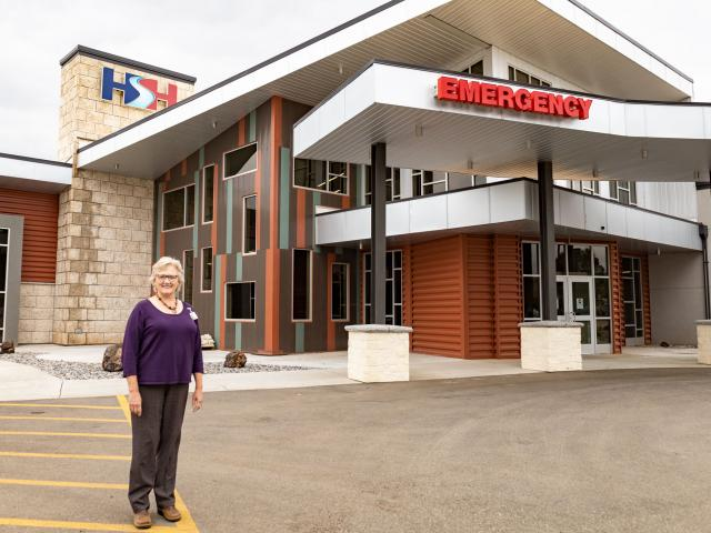 Hot Springs Health CEO Margie Molitor stands in front of the newly expanded and updated hospital in Thermopolis, Wyoming