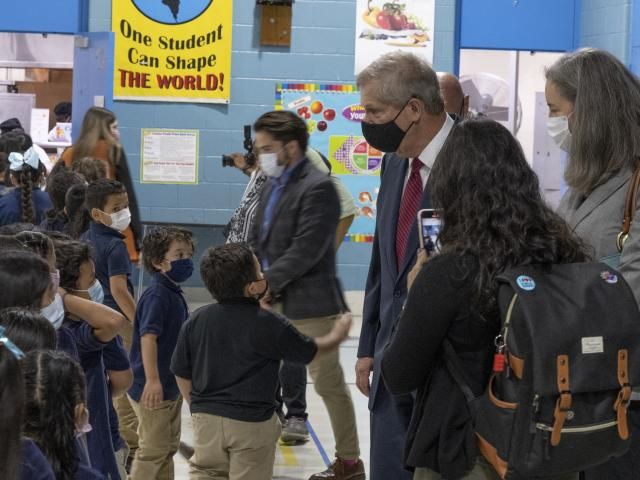 Agriculture Secretary Tom Vilsack tours Riverdale Elementary School during the lunch service