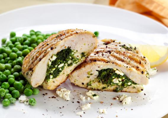 Grilled chicken breasts stuffed with spinach and feta cheese