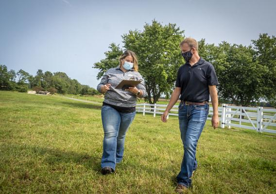 FSA Program Technician Jessica Clarke talks with Maryland producer Ethan Whiteside