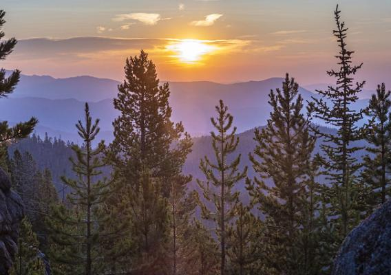The sunrise over the Whitetail Mountains from the East Ridge near Butte, Montana