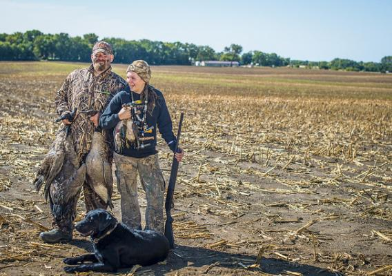 Justin Fevold and daughter Payton Fevold 14, from Gilmore City, Iowa, show off the results from a Youth Waterfowl hunting day outside of Gilmore City, Sept. 17, 2017.
