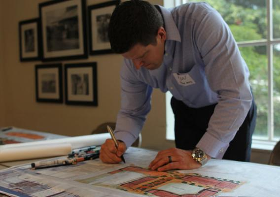 Architect Ron Batcher drawing plans for a downtown market