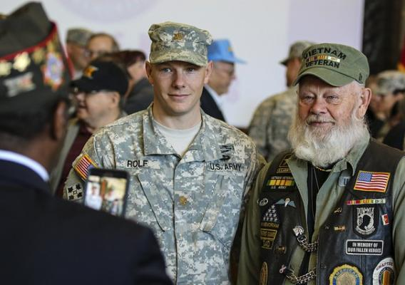 Army Maj. Zach Rolf poses for a photo with his father and Vietnam War veteran, Lynn Rolf