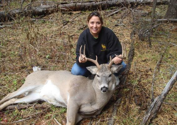 Sandra Broncheau-Mcfarland with a white tail buck taken during a hunt