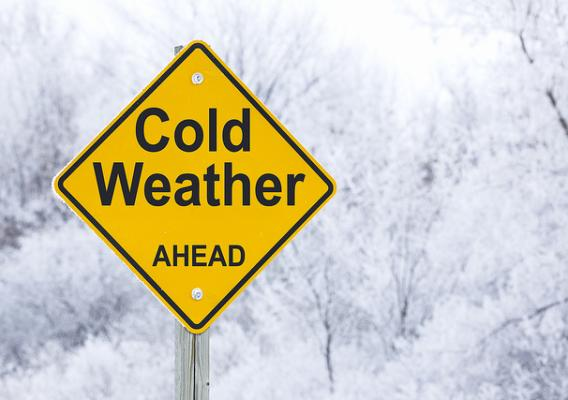 A cold weather ahead road warning sign