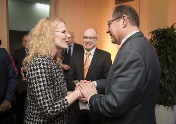 Kelly Stange, an Agricultural Counselor for Germany, Austria, Hungary & Slovenia with USDA's Foreign Agriculture Service greets Christian Schmidt, German Federal Minister of Food and Agriculture