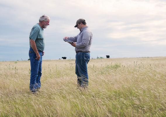 Rancher Larry Mattlage with NRCS district conservationist Clete Vanderburg