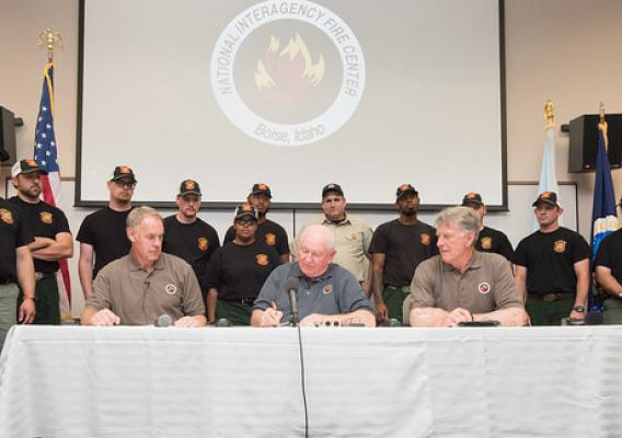 U.S. Department of Agriculture Secretary Sonny Perdue, Interior Secretary Ryan Zinke sign a memorandum to wildland fire leadership in Boise, Idaho, on June 2, 2017. USDA Photo by Lance Cheung.