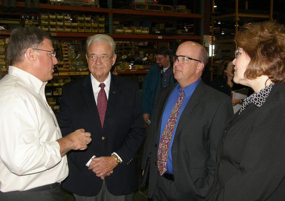 Congressman Leonard Boswell; Judy Canales, USDA Rural Business Programs Administrator; and Bill Menner, USDA Rural Development State Director in Iowa (Next to Canales on Right), listen to Pat Weiler (left) as he talks about upcoming changes at Weiler's manufacturing facility.