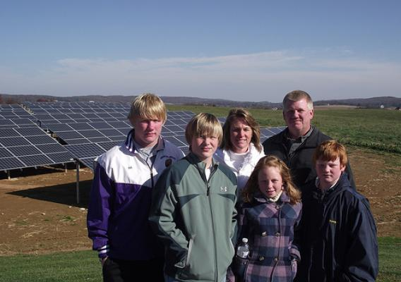 Brad Rill, Vice President of Sunnyside Farms is pictured with his wife Tracey and children Tyler, Logan, Molly and Keegan in front of the solar panel array that supports the families chicken-egg production facility in Westminster.  Sunnyside Farms gathers 29,000 dozen eggs per day.