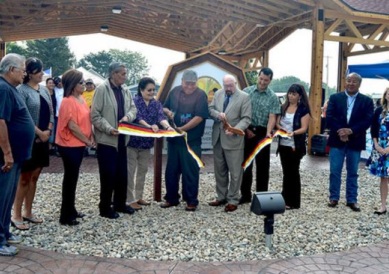 U.S. Dept. of Agriculture Rural Development State Director for Michigan James J. Turner (fifth from right) cutting the ribbon for the Mt. Pleasant Native Farmers Market with Saginaw Chippewa Indian Tribal Chief Steve Pego