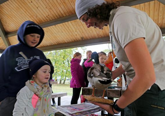 As the traveling Forest Service representative, Teresa Butel helped facilitate the migration station by talking to students about different native bird species (Photo Credit: Julia Schwitzer, Wilderness Inquiry).