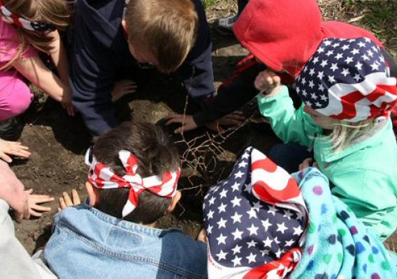 Lidgerwood kindergarten students planting one of seven Hackberry trees donated by USDA Natural Resources Conservation Service.