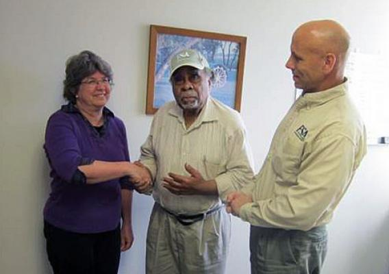 At 92, Malachi Duncan (center) is still farming in Union, S.C. Pictured with Duncan are Cinda DeHart, farm loan tech and John McComb, farm loan officer.