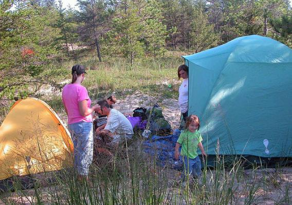A family sets up camp on the 3,450-acre Nordhouse Dunes Wilderness Area in Michigan's lower peninsula. (U.S. Forest Service)