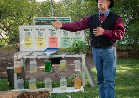 Oklahoma Conservation Commission Soil Scientist Greg Scott talks about the practical benefits of best soil management practices during NRCS' soil health demonstration earlier this month. USDA Photo by Lance Cheung.