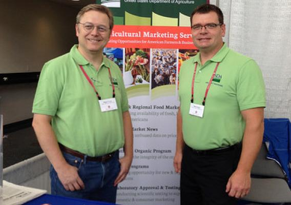 USDA Dairy Program's Roger Cryan, Director of the Economics Division (left), and Butch Speth, National Supervisor of Dairy Market News, answered questions and spoke with stakeholders at the 2014 World Dairy Expo in Madison, Wisconsin.