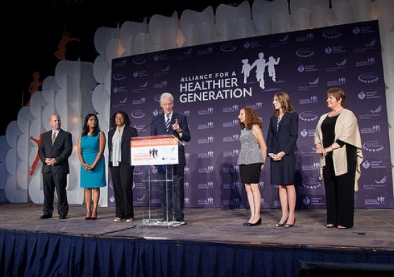 Principal Kimberly Norton of Danville, Ill (second from right) stands on stage with President Clinton at the 2014 Leaders Summit hosted by the Alliance for a Healthier Generation. Photo credit: Scott Henrichsen