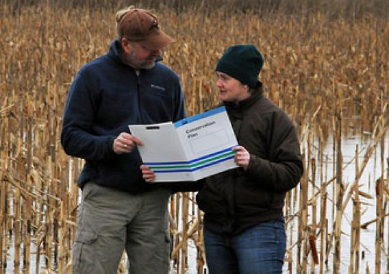 Richard Clifton and NRCS soil conservationist Brooke Brittingham reviewing a conservation plan