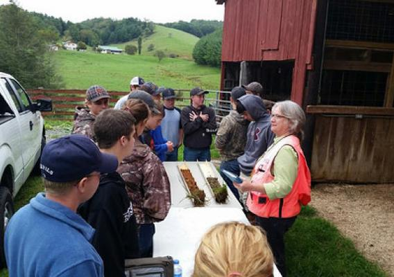 NRCS Resource Soil Scientist Jeannine Freyman using a soil profile to highlight differences in soil types and their suitability for agriculture and other uses at a workshop on the New River Hill Farm