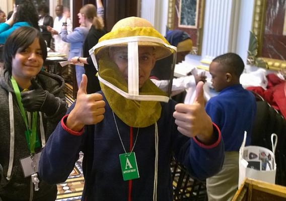 Students from Baltimore and Washington, D.C. schools trying out different scientific careers like ARS bee researcher at the White House Day at the Lab