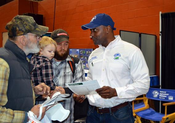 King Whetstone, (right), regional director of USDA's National Agricultural Statistics Service Northeastern Regional Field Office, meeting with attendees