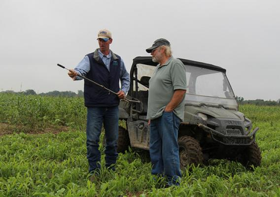 NRCS employee works with farmer