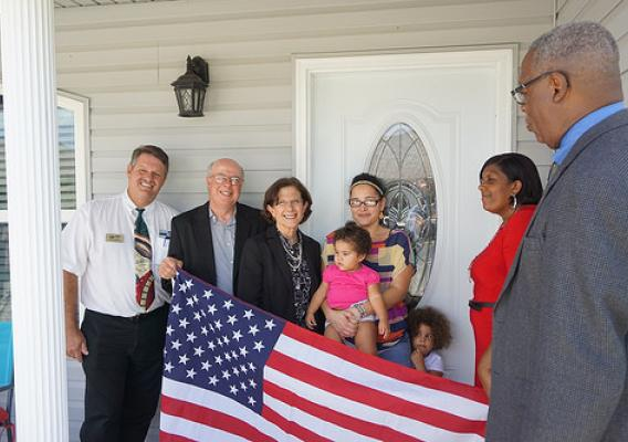 USDA RD officials and Little Dixie Community Action Agency celebrated HOM with new homeowner, Caysa Mejia and family, in St. Charles Parish and presented a flag to the new home owner