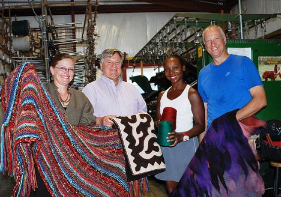 Business Program Specialist Deborah Rausch, Ohio Rural Development State Director Tony Logan, Toia Rivera-Strohm and Brad Strohm show off local textiles from the VonStrohm Woolen Mill & Fiber Arts Studio in Pickaway County. The small business was awarded VAPGs in 2010 and 2012. (USDA photo)