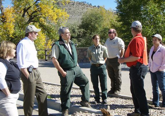 Undersecretary Robert Bonnie (second from left) is briefed by NRCS Soil Conservationist Don Graffis.  Graffis discussed  NRCS recovery efforts in the wake of a 2013 flood near Lyons Colorado. NRCS photo.