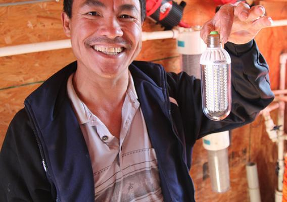 Stanley Lee has put more efficient light bulbs in his chicken houses and made other updates that lower his carbon footprint.