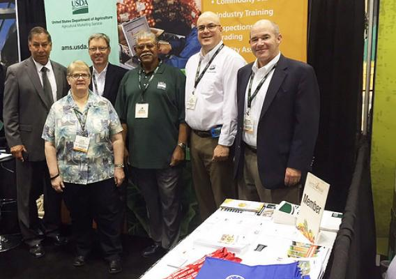 A team of AMS employees staffing a booth at the United Fresh Convention and Expo