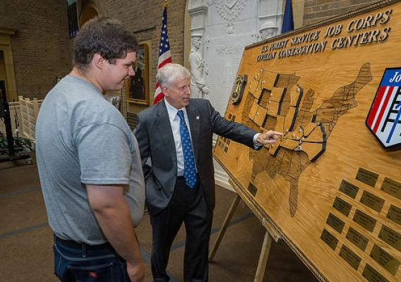 Daniel Stevenson, carpentry student of the Harpers Ferry Job Corps Center shows Tom Tidwell, Chief, U.S. Forest Service a map he created of the 28 Job Corps Centers in the United States at the 50th Anniversary of the Job Corp Civilian Conservation Centers celebration at the United States Department of Agriculture in Washington, DC, Wed. Sept. 17, 2014. The U.S. Forest Service operates the Job Corps Civilian Conservation Corps, the Nation's largest residential, educational and career technical training progr