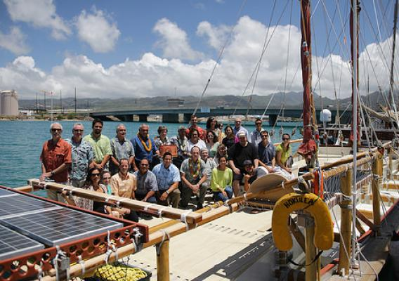 Representatives from multiple conservation groups aboard the Hokule'a, a double-hulled voyaging canoe. The Hokule'a will carry a signed pledge promoting world conservation to its 26 ports of call. (Courtesy Hawaii Conservation Alliance)
