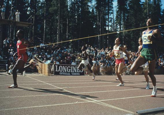 John Carlos breaks the tape and sets a world record of 19.7 seconds in the 200-meter final during the Olympic Trials in September 1968. Tommie Smith (right) placed second, and Larry Questad (red shorts and white jersey) was third. (Courtesy Track & Field News/Rich Clarkson)